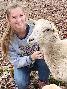 Madison Poole with Sheep