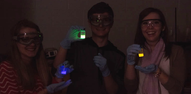 Student workers make glowsticks in lab