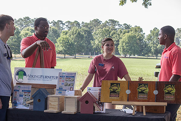 Students selling Viking Furniture
