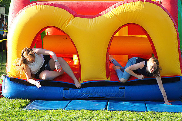 Students falling out of a bounce house