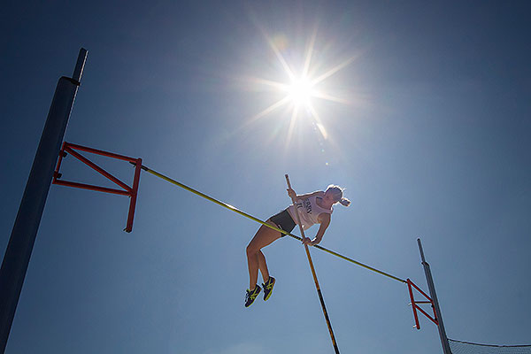 08 - Woman pole vaulting with sun overhead