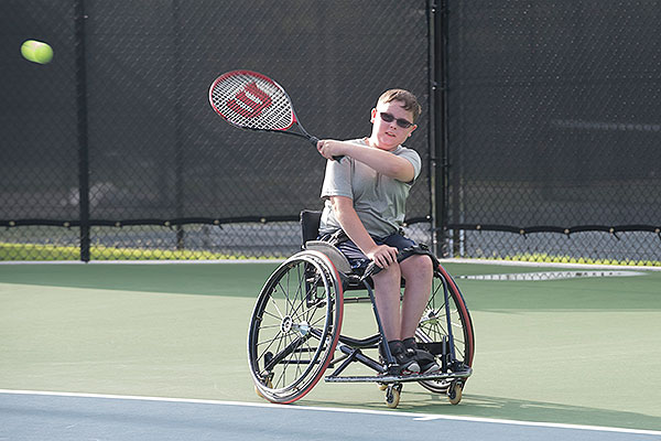 06 - Boy in a wheelchair hitting a tennis ball
