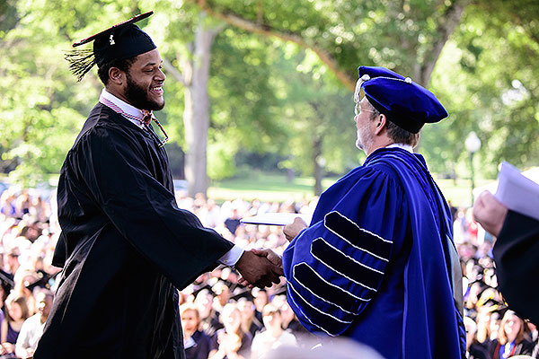 11 - Stephen Stamps shaking hands with President Briggs as he receives his diploma
