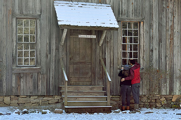11 - Couple looking in the windows of Possum Trot