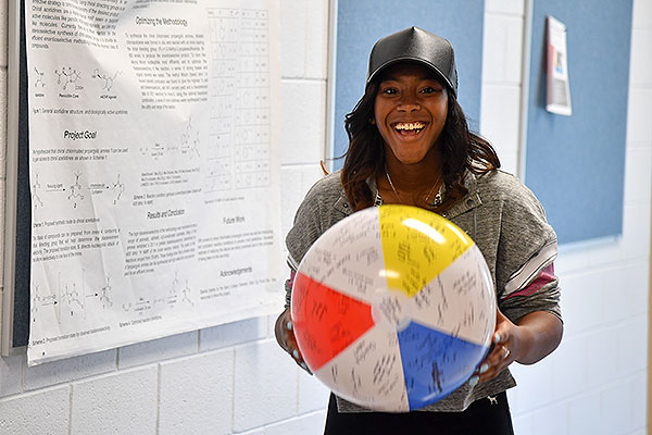 06 - Female student holding a beach ball