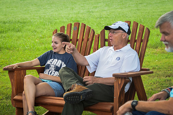 03 - Two people sitting in Adirondack chairs