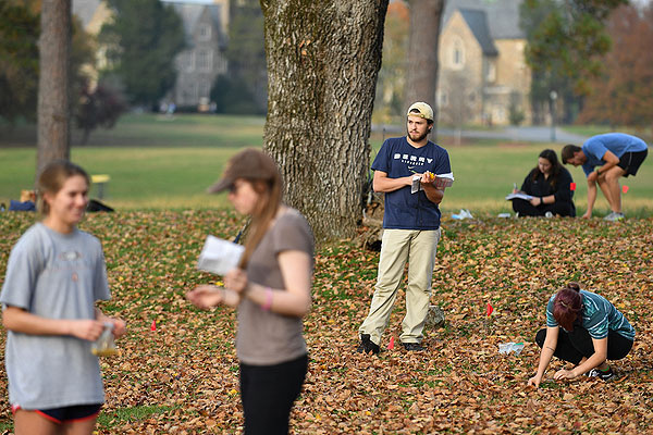 04 - Students doing a fall Ecology lab in the leaves
