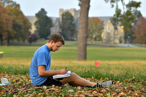 06 - Student sitting in leaves