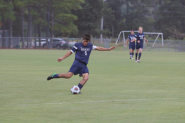 09 - Male soccer player kicking ball