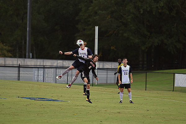 10 - Male soccer player jumping to head ball