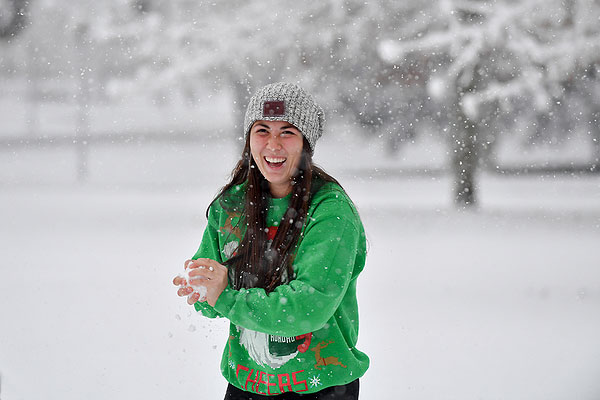 04 - Student in green sweatshirt getting ready to throw a snowball
