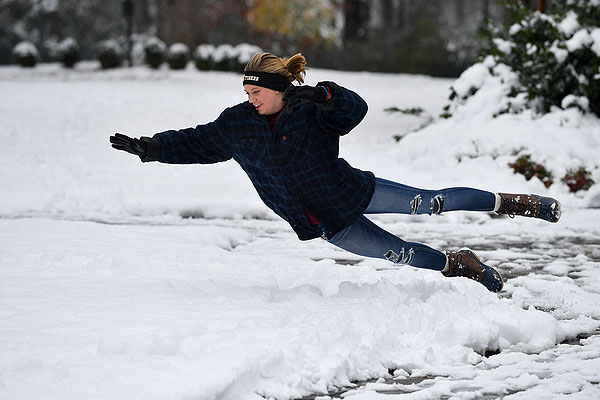 12 - Student jumping into a pile of snow