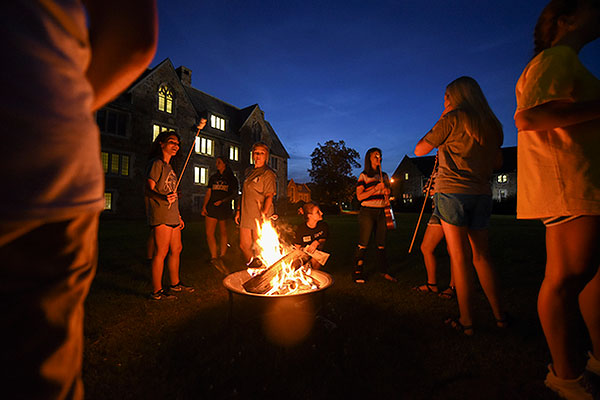 11 - New students roasting marshmallows at night