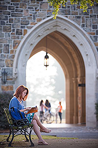 Student Studying by Ford Archway
