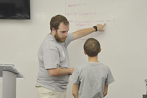 Travis Helton instructing a student